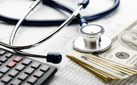 Stethoscope and calculator symbol for health care costs or medical insurance 스톡 콘텐츠