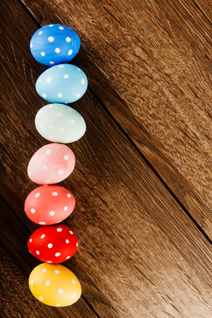 Easter eggs on wooden table background with copy space photo