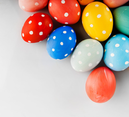 Easter eggs painted in pastel colors on a white background photo