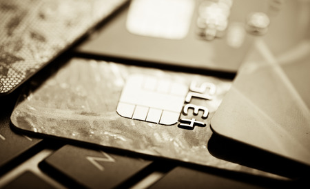 E-commerce concept. group of credit cards and laptop with shallow DOF Standard-Bild