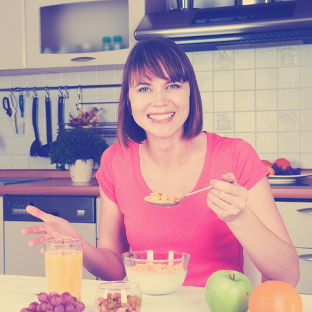 brune: Beautiful woman having a healthy breakfast filtred image Stock Photo