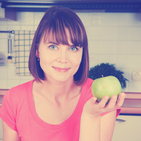 brune: Beautiful woman and green apple  filtred image Stock Photo