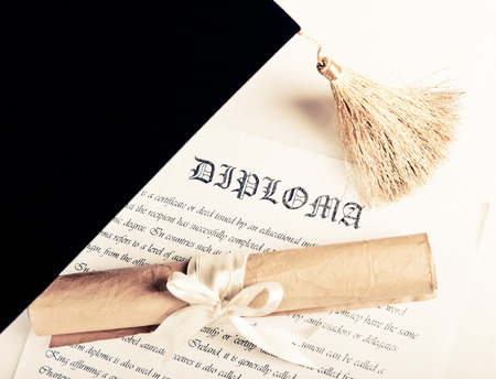 Graduation hat and Diploma 스톡 콘텐츠