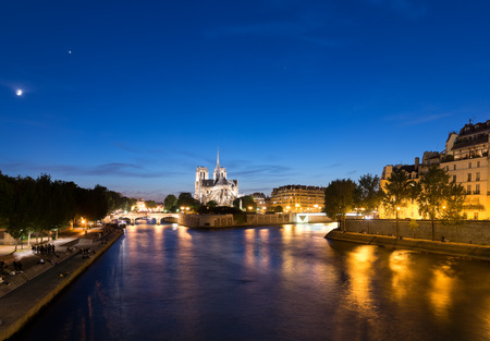 dam square: Notre Dame de Paris Cathedral at night. Stock Photo