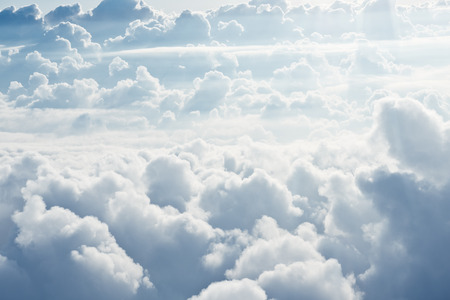 view from the above: Aerial view on white fluffy clouds Stock Photo