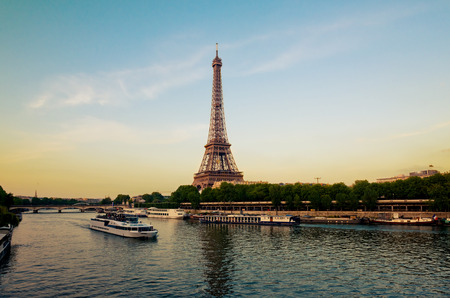 Eiffel Tower with boats in evening Paris, France