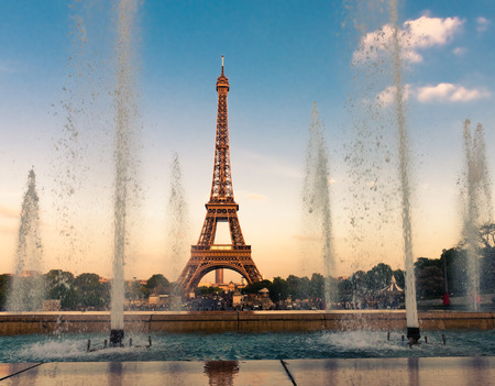 Eiffel Tower (La Tour Eiffel) with fountains. Beautiful sunset landscape in Paris