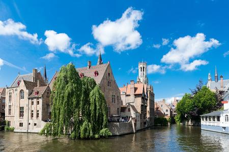 west river: medieval houses, Rozenhoedkaai in Brugge, Dijver river canal and Belfort (Belfry) tower, West Flanders