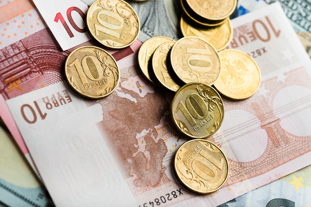 roubles: russian rubles coins on the European banknotes (five and ten)