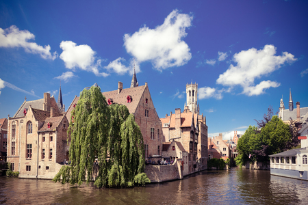 belfort: medieval houses, Rozenhoedkaai in Brugge, Dijver river canal and Belfort (Belfry) tower, West Flanders. Instagram style filtred image