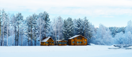 freshly fallen snow: Wooden houses in a nature area covered with freshly fallen snow. Editorial