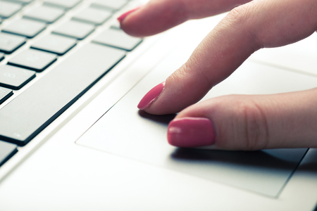 trackpad: Close-up shot touching laptop trackpad. Focused on fingers at trackpad Stock Photo