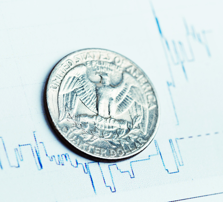 fluctuate: american coin on fluctuating graph. Rate of the dollar (shallow DOF) Stock Photo