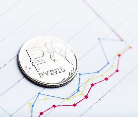 fluctuate: One rouble coin on fluctuating graph. Rate of the Russian rouble (shallow DOF)