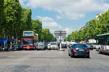elysees: PARIS, MAY 22 2015:A lot of cars on the Avenue des Champs-elysees. Avenue des Champs Elysees is the biggest and most famous and expensive boulevard in the world