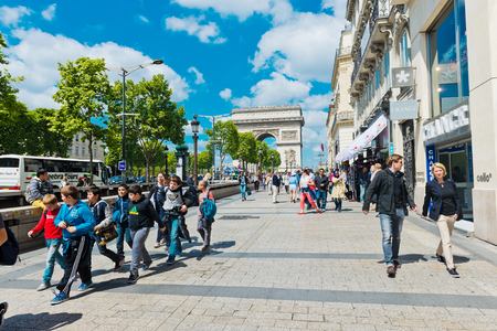 elysees: PARIS, MAY 22 2015: tourisrs on the Avenue des Champs-elysees. Avenue des Champs Elysees is the biggest and most famous and expensive boulevard in the world
