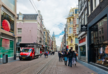 AMSTERDAM, NETHERLANDS - JUNE 01, 2015:  Typical view of streets of Amsterdam in summer.  Amsterdam is the capital city and most populous city of the Kingdom of the Netherlands