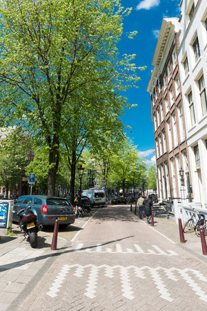 durability: AMSTERDAM, NETHERLANDS - JUNE 01, 2015:  Typical view of streets of Amsterdam in summer.  Amsterdam is the capital city and most populous city of the Kingdom of the Netherlands