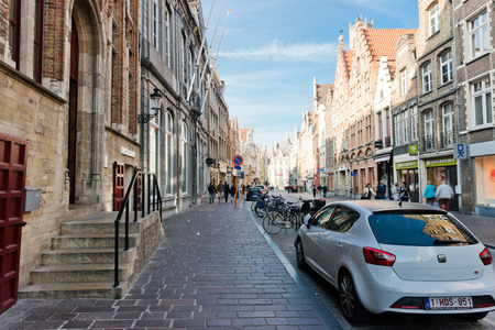 benelux: Bruges, Belgium - MAY 27, 2015:Tourist walking on the street in Bruges, Belgium. Bruges is the capital and largest city of the province of West Flanders in the Flemish Region of Belgium. Editorial