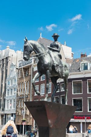 AMSTERDAM, NETHERLANDS - JUNE 01, 2015: The equestrian statue of Queen (Ruiterstandbeeld koningin Wilhelmina) in Amsterdam