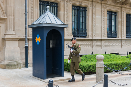duke: LUXEMBOURG, LUXEMBOURG - MAY26, 2015: Guard in front of Grand Ducal Palace in Luxembourg. It is the official residence of the Grand Duke of Luxembourg, built in 1572.