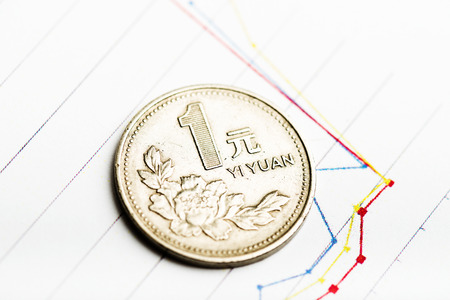 fluctuate: Chinese One Yuan Coin and Fluctuating graph. Rate of the Chinese Yuan (shallow DOF) Stock Photo