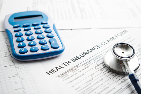 health care costs: health care costs or medical insurance Stock Photo