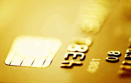 cashpoint: Credit cards. Golden toned. Business Stock Photo