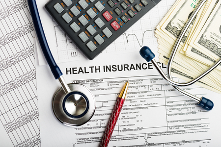health care costs: Stethoscope and calculator, symbol for health care costs or medical insurance