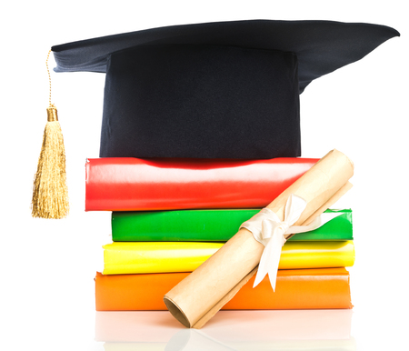 rewarded: mortarboard and vintage graduation scroll, tied with  ribbon, on a stack of books