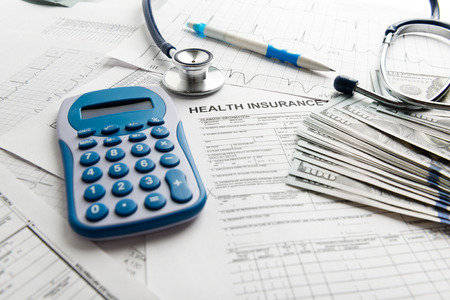 savings problems: Stethoscope and calculator symbol for health care costs or medical insurance Stock Photo