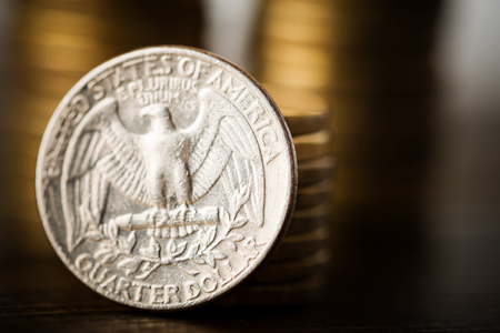 us coin: us quarter dollar coin and gold money on the desk Stock Photo