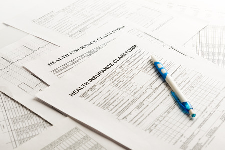 compensate: health insurance form, paperwork and questionnaire for insurance concepts
