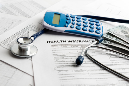 health care costs: Stethoscope and calculator symbol for health care costs or medical insurance Stock Photo