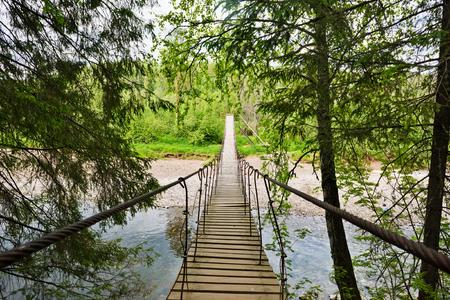 kavkaz: Suspension bridge, Crossing the river