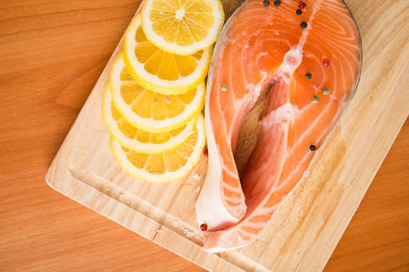 Salmon fillet with rosemary and lemon   Stock Photo