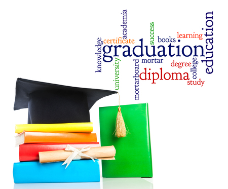 academia: mortarboard and vintage graduation scroll, tied with  ribbon, on a stack of books  Stock Photo