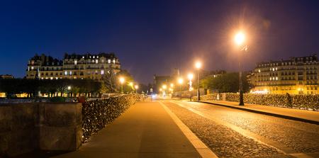 stone of destiny: Pont de la Tournelle bridge at night in Paris, France Stock Photo