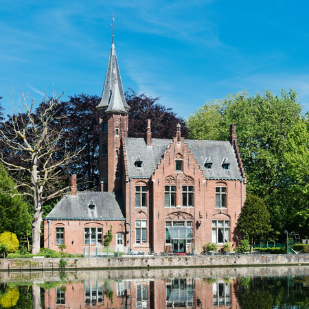 Medieval building (Castle) on Love lake, Minnewater Park in Bruges, Belgium Editorial