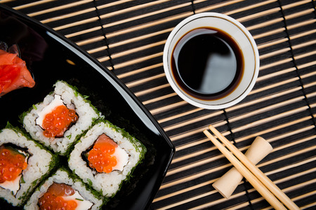 Sushi set served on a black plate   Stock Photo