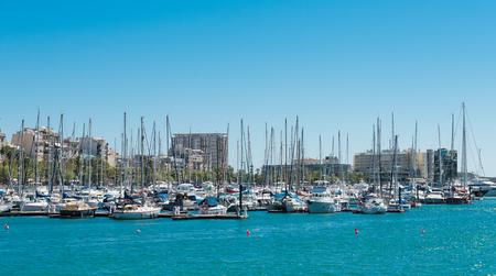 BARCELONA, SPAIN - SEPTEMBER 14, 2012: Marina in port Vell in Barcelona. More than 7 million visitors were in Barcelona in 2012.