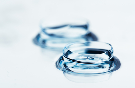 Two contact lenses with reflections