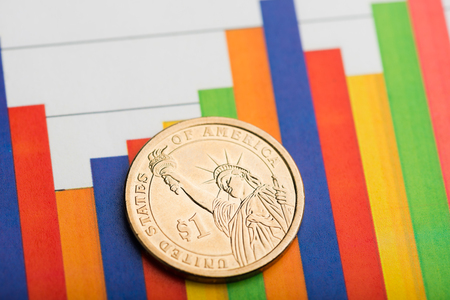 one dollar coin on fluctuating graph. Rate of the us dollar (shallow DOF) Stock Photo