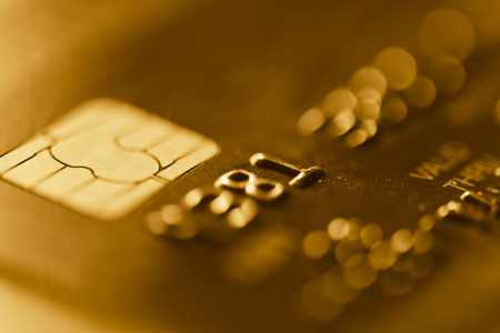 Credit cards. Golden toned. Business Stock Photo