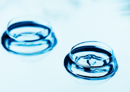 Two contact lenses with reflections 版權商用圖片 - 112367854