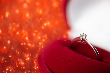 Box with engagement ring, marriage proposal. Glitter background 免版税图像