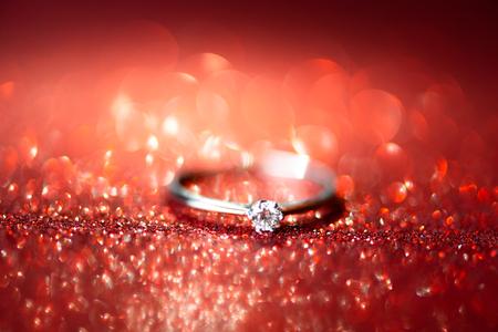 Elegant diamond ring. Glitter background