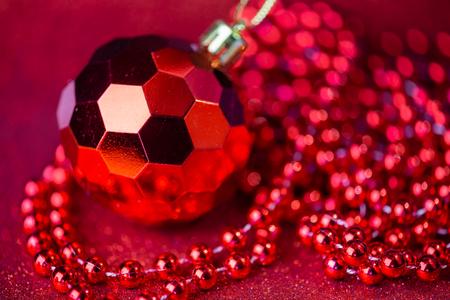 red christmas balls on glitter background