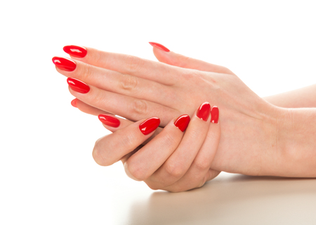 female hands with red manicure on white Stock Photo