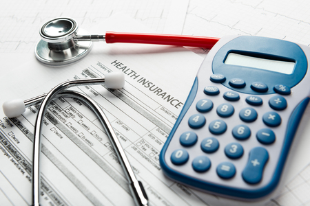Stethoscope and calculator symbol for health care costs or medical insurance Archivio Fotografico